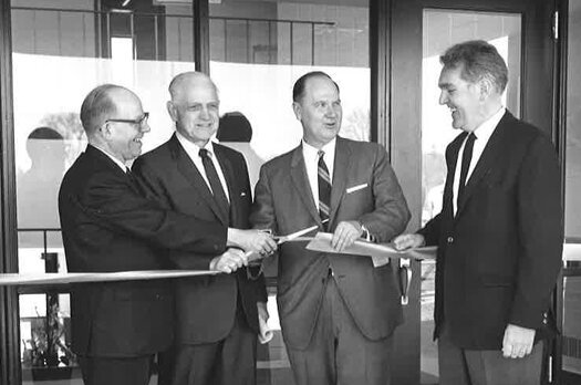 Lucius Chase, second from left, stands next to Lakeland President John Morland (third from left) during the ceremony on the day the Chase Science Center was named after Chase.